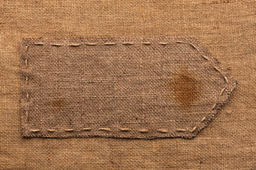 Arrow of burlap, lies on a background of burlap