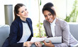 Image of two friendly businesswomen sitting