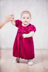 Baby girl in red dress