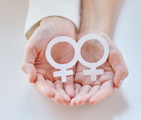 close up of happy lesbian couple with venus symbol