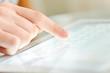 Leinwandbild Motiv Hand touching screen on modern digital tablet pc.