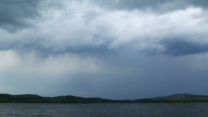 approaching storm - storm clouds over lake