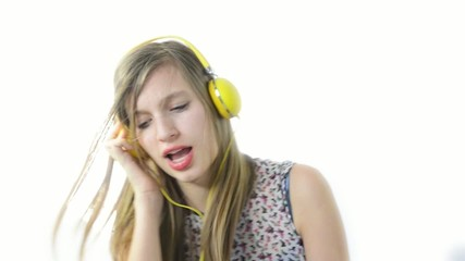 a teenage girl dance with headphone in slow motion