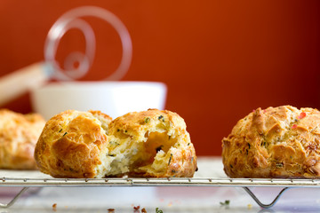 Cheese herb rolls on cooling rack. French gougere. Close