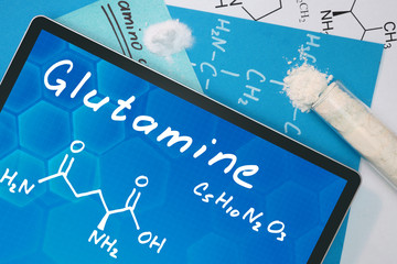 Tablet with the chemical formula of Glutamine  . Amino acids.