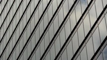 Time Lapse of Clouds Reflection on Glass Office Building in Tokyo Japan
