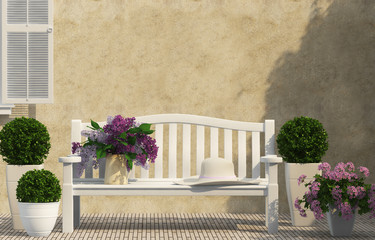 White bench, green and lilac flowers