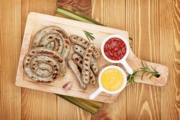 Grilled sausages with ketchup and mustard