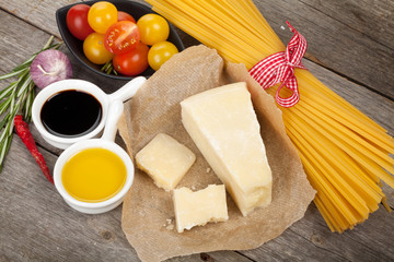Parmesan cheese, pasta, tomatoes, vinegar, olive oil, herbs and