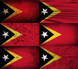 Set of 6 flags of East Timor with old texture. Vector