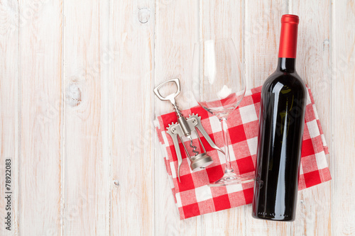 canvas print picture Red wine bottle, glass and corkscrew