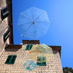 Umbrellas hanging for decoration of street in Kotor, Montenegro.