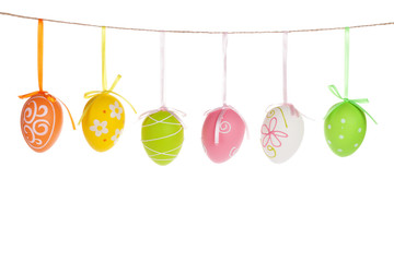 Colorful easter eggs hanging on rope
