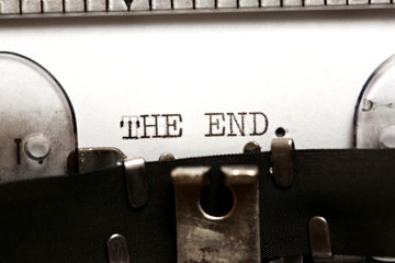 Word THE END written on an old typewriter
