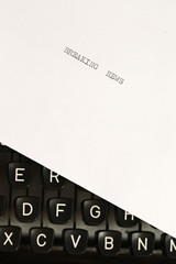 Breaking news written on an old typewriter
