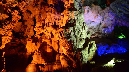 Colorized Stalactites hang from Cave Ceiling in Ha Long Bay Vietnam