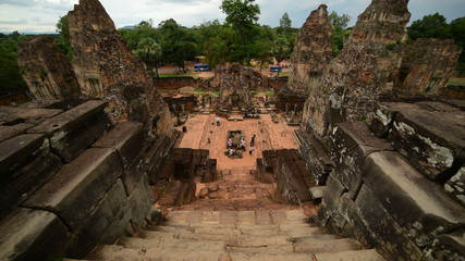 Looking Down Temple Steps as Tourists walk around the Altar - Angkor Wat, Cambodia