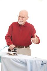 Senior Man Irons His Shirt