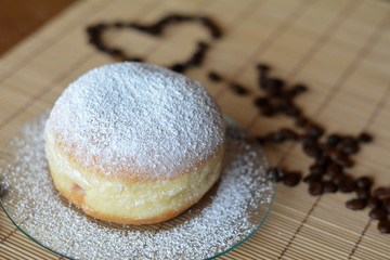 Donut with powdered sugar on the brown plate