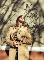 Seductive glamorous brunette wearing stylish clothes posing outs
