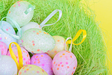 Closeup easter eggs in green nest