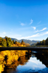 California Russian River bridge, scenic fall color. Sonoma