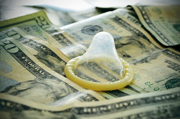 dollar banknotes and condom