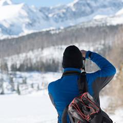 Photographer capturing winter landscape