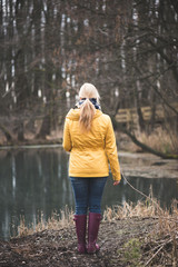 Woman enjoying lake view in the forest