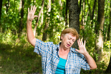 Lonely grandma in the forest in a depression
