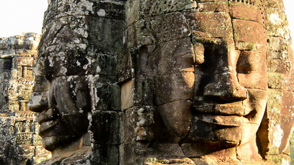 Zoom Out of Stone Statue of Buddha  - Angkor Wat, Cambodia
