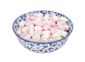 Pink and white mini marshmallows in a blue and white china bowl