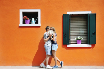 couple in a sunny day in Burano, Venice, Italy