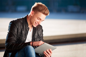 Young student with tablet, outside