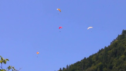 Paragliding on Mount Harder Kulm background. Interlaken