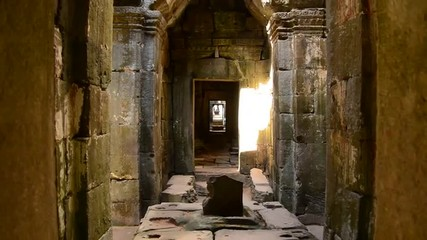 Zoom Out of Temple Hallway with Sunlight Shining In  - Angkor Wat Temple Cambodia