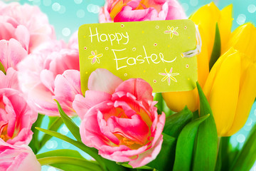 Easter bouquet of spring flowers with greeting card