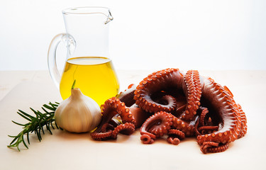 Boiled octopus with garlic, rosemary and olive oil