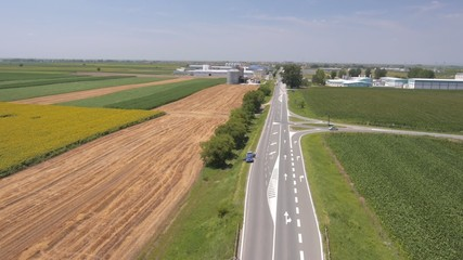 Aerial view on the roads, highway and agriculture fields close t