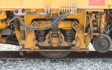 closeup wheel break and suspension system of diesel train