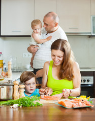 parents with children docile fish cooking in a home kitchen