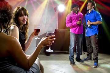 mixed crowd drinking and socializing in a nightclub