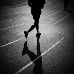 silhouette man jogging and running on track