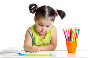 Cute child drawing with colorful crayons