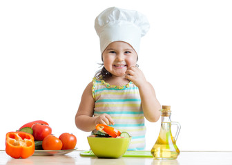 child preparing healthy food in the kitchen