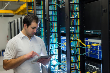 IT technician with network equipment and tablet