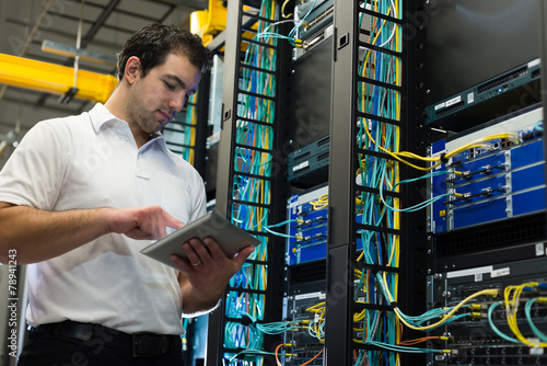 IT technician with network equipment and tablet - 78941243