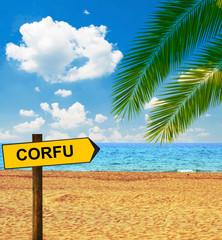 Tropical beach and direction board saying CORFU