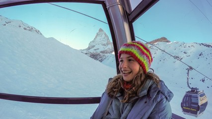 Ski, girl in the cable car, the Matterhorn in the back