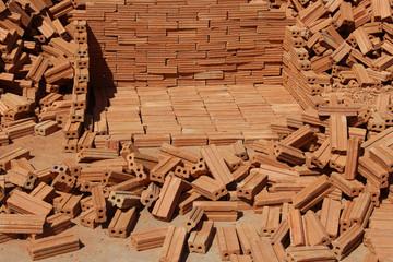 stacking bricks in daylight